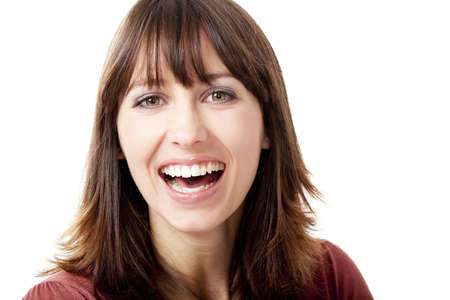 Beautiful woman looking at camera and laughing, isolated on a white background Stock Photo - 12436325