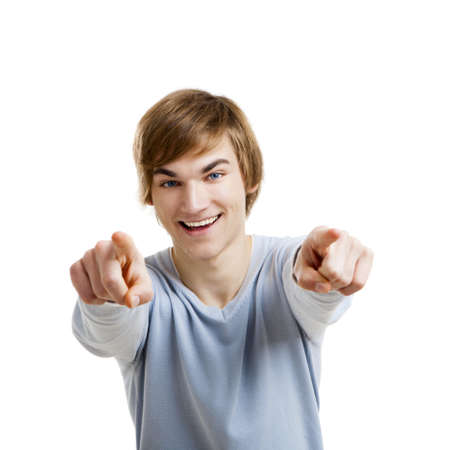 Portrait of a handsome young man looking and pointing to the camera, isolated over a white background Reklamní fotografie