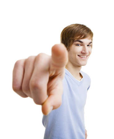 Portrait of a handsome young man looking and pointing to the camera, isolated over a white background Stock Photo - 12436219