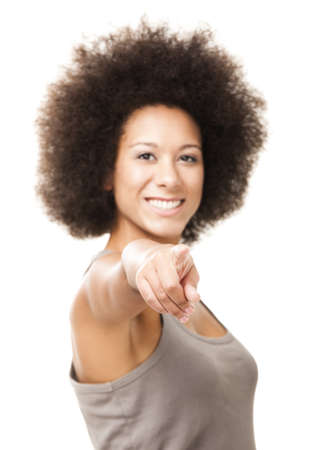 Happy Afro-American young woman isolated on white looking and pointing to the camera Stock Photo - 12669854