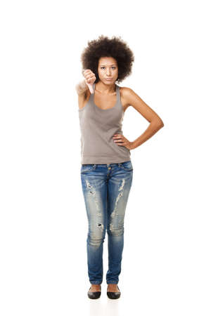 Afro-American young woman isolated on white doing a thumbs down signal with her hand photo