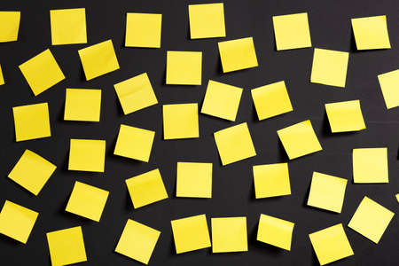 post it notes: Background image of yellow notes on a black board