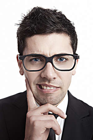 dumb: Funny portrait of a young businessman with a nerd glasses