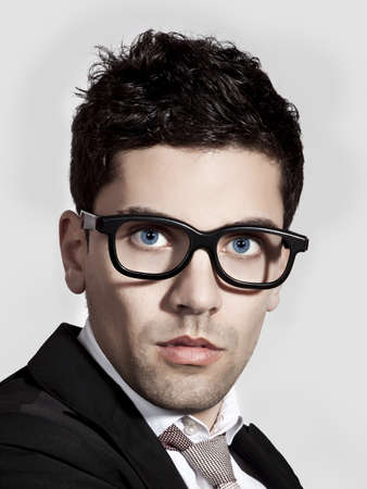 Portrait of a young and fashion businessman with nerd glasses photo
