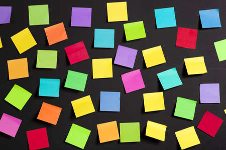 it background: background image of multicolor notes on a black board