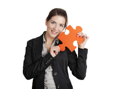 Business woman holding a big puzzle piece, isolated on white Stock Photo - 12670084