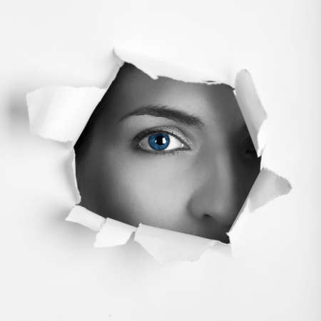 keek: Beautiful female blue eye looking through a hole on a sheet of paper