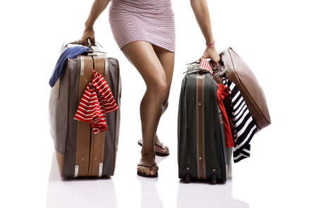 carrying girl: Beautiful and happy young woman carying the baggage with clothes