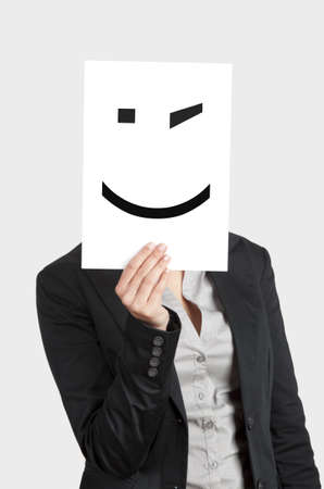 Woman showing a blank paper with a smile winking in front of her face Stock Photo - 12955160