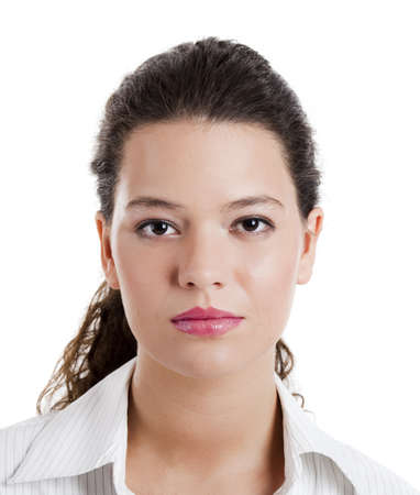 Portrait of a beautiful young woman with a serious expression photo
