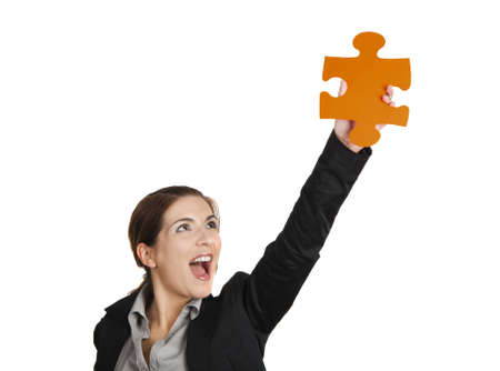 Happy business woman holding a big piece of puzzle, isolated on white Stock Photo - 12955147