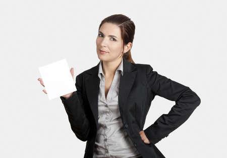 Beautiful business woman holding a blank card photo