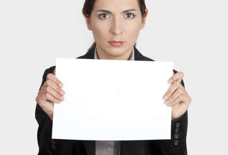 Beautiful business woman holding a blank card Stock Photo - 12955148