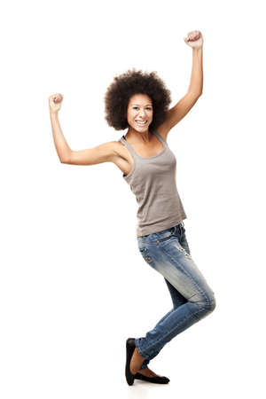 Happy Afro-American young woman isolated on white with arms on the air Stock Photo - 13359290