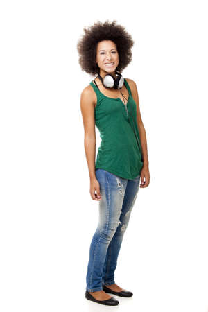 Beautiful happy woman holding headphones, isolated on white backgorund photo