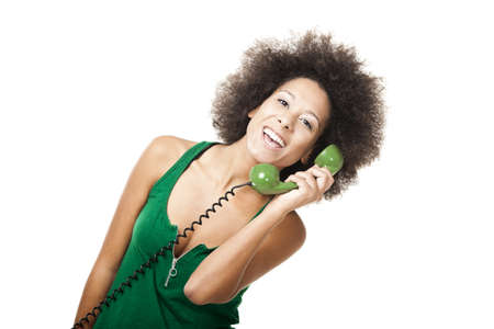 retro phone: Afro-American young woman answering a call, isolated on white background