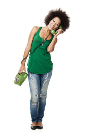 Afro-American young woman answering a call, isolated on white background Stock Photo - 13359326