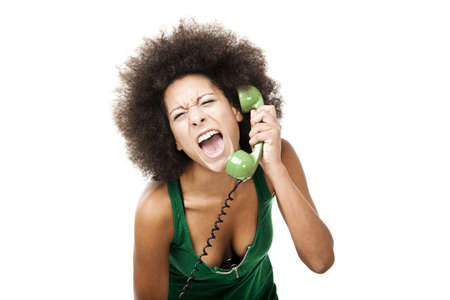 Afro-American young woman answering a call and yelling at phone, isolated on white background photo