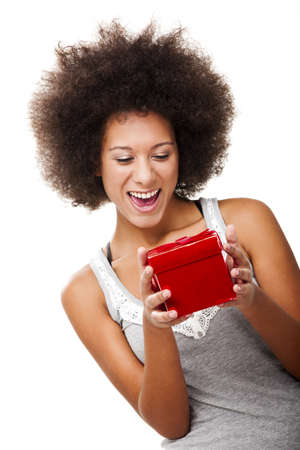 Beautiful happy young woman holding a red christmas gift, isolated on white Stock Photo - 13375372