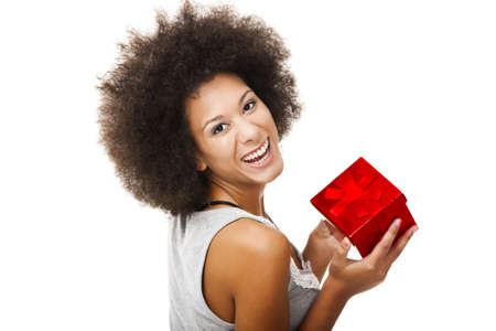 Beautiful young woman holding a gift, isolated on white Stock Photo - 13359289
