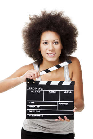 Beautiful african american woman holding a clapboard, isolated on white photo