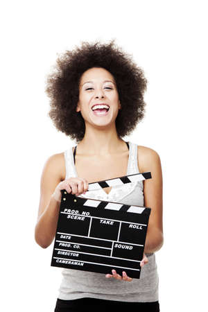 Beautiful african american woman laughing and holding a clapboard, isolated on white Stock Photo - 13359389