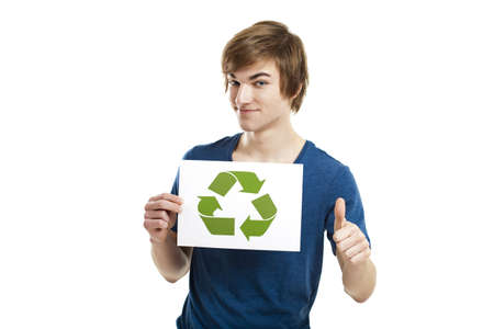 Casual young man holding a recycling sign to promote a green and better world, isolated on white background photo