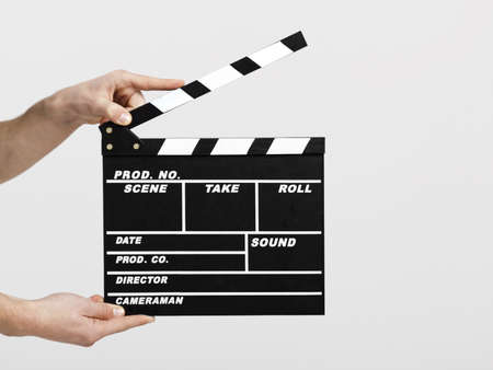 clapper: Male hands holding a clapboard, great conceptual image for ex, a new start your business Stock Photo