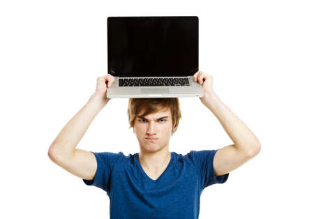laptop stand: Handsome young man holding a laptop isolated over a white background