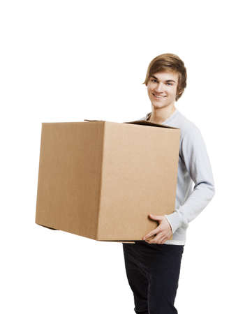heavy lifting: Portrait of a handsome young man holding a card box