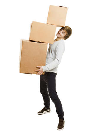 service lift: Portrait of a handsome young man holding card boxes, isolated on white Stock Photo