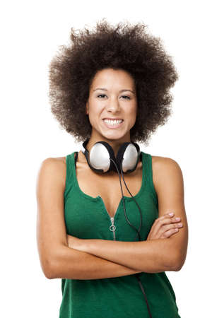 Beautiful happy woman with headphones looking to the camera, isolated on white  photo