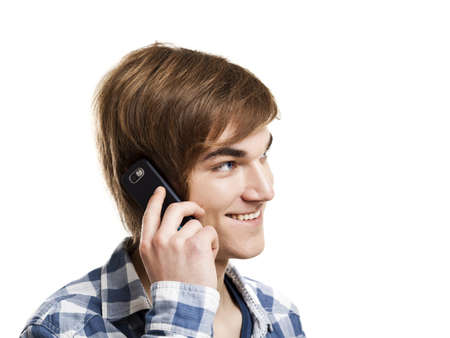 Portrait of handsome young man using mobile phone, isolated on white background photo
