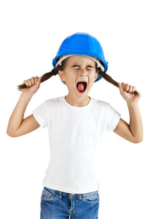 Little young girl yelling and wearing a protection helmet, isolated on white background
