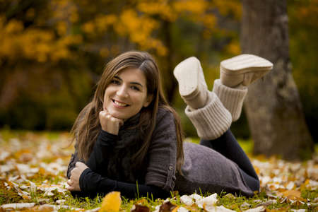Woman relaxing in a beautiful day of autumn Stock Photo - 15264685