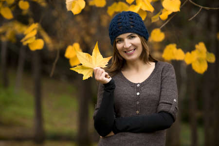 Happy woman in a beautiful autumn day Stock Photo - 15264714