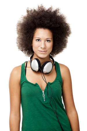 Beautiful woman with headphones on the neck, isolated on white  photo
