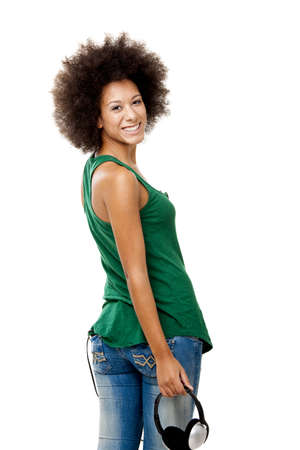 Beautiful happy woman holding headphones, isolated on white backgorund Stock Photo - 15264710