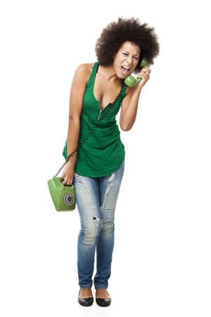 Afro-American young woman answering a call and yelling at phone, isolated on white background Stock Photo - 15264702