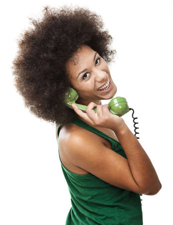 Afro-American young woman answering a call, isolated on white background  photo