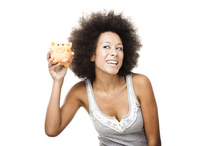 economizing: Woman holding and shaking a piggy bank