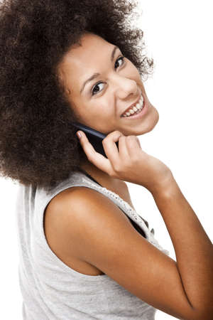Beautiful African American woman talking on cell phone, isolated on white background photo