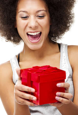 Beautiful happy young woman holding a red christmas gift, isolated on white Stock Photo - 15264718