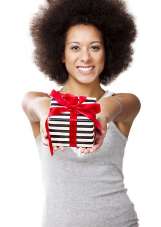 Beautiful young woman holding a gift, isolated on white photo
