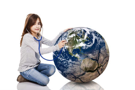 auscultate: Portrait of a little girl auscultate the health of the planet earth with a stethoscope, isolated on white background