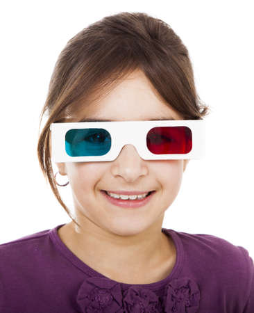 Beautiful little girl wearing 3d glasses and smiling, isolated over a white background Stock Photo - 15264704