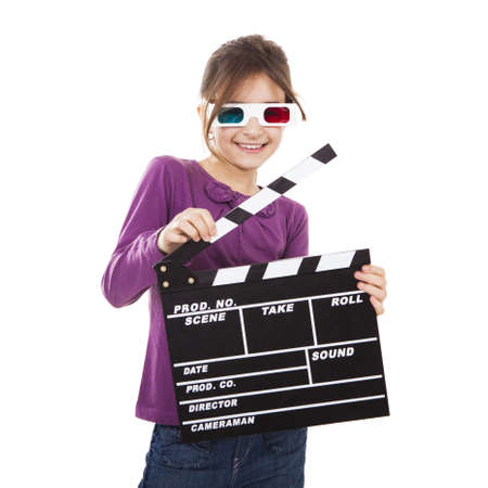 clapper: Beautiful little girl wearing 3d glasses and holding a clapboard, isolated over a white background Stock Photo