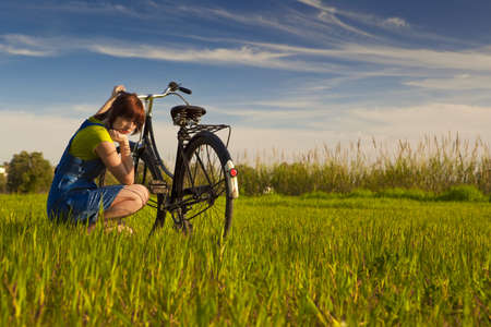 Young woman really anoyed beacuse of her to broken bicycle Stock Photo - 15760647