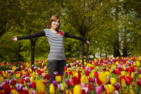 Beautiful woman surrounded by tulips of all the colors Stock Photo - 15760644