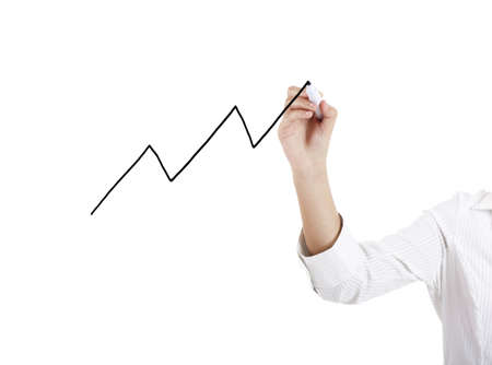 Female hand of a young businesswoman drawing a graphic chart photo